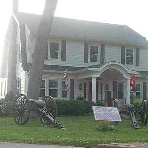 House with Cannons and Placque in Yard