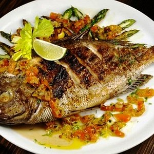 Fried local Fish, topped with herbs & spices
