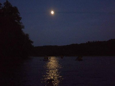 Full Moon on the river with a group of kayakers