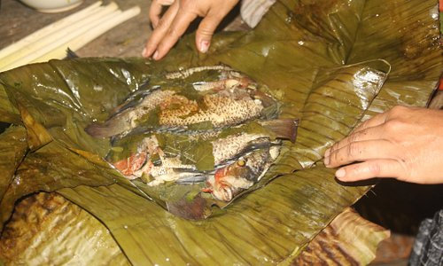 Fish from the river baked in waha leaves