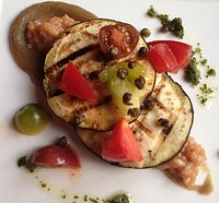 Eggplant with eggplant puree, tomato risotto, heirloom tomatoes and fried capers