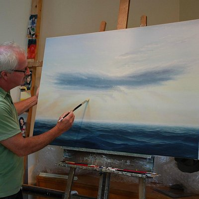 Busy at the easel in his studio. Doug paints in oil on canvas and linen.