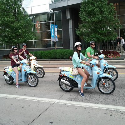 Off for adventure on rented mopeds from ScooTours Denver. Leaving the Hyatt Regency.