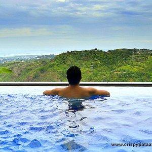Infinity pool overlooking Antipolo mountains, Laguna De Bay and Metro Manila
