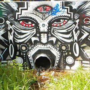 Artwork created around a drainage pipe.