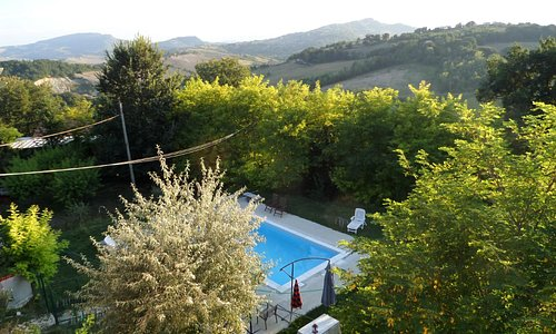 view of swimming pool and countryside