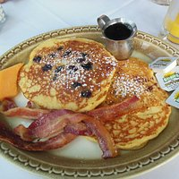 Blueberry pancakes with bacon and maple syrup. Yum!