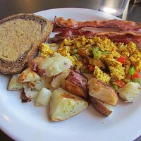 Tofu scramble, bacon, potatoes, rye swirl toast