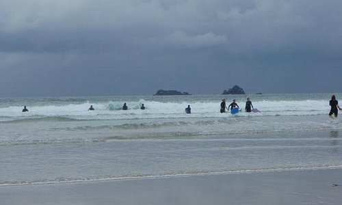 body surfing on a rainy day at Constantine Bay