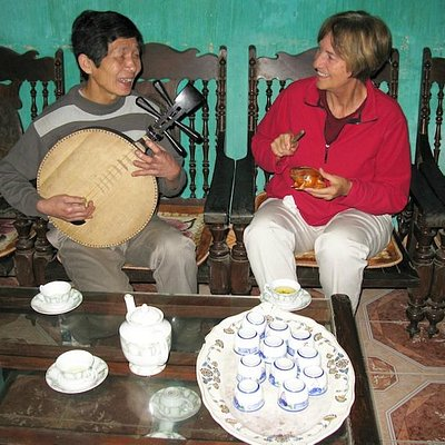 Enjoying culture exchange with local villager at Tho Ha Village, outside Hanoi.