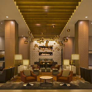 Arriving guests are greeted with linear stacked fireplaces on a 29 ft wall.