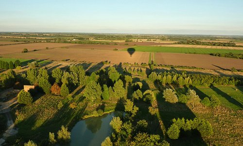 reflection of the balloon in the landscape