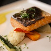 Salmon on veggies. Perfectly cooked.