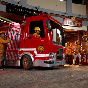 Kids role-playing as fire-fighters at KidZania Mumbai