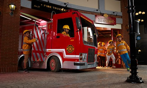 Kids role-playing as fire-fighters at KidZania Mumbai