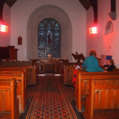 inside of church with the heaters on to take the chill off an old building