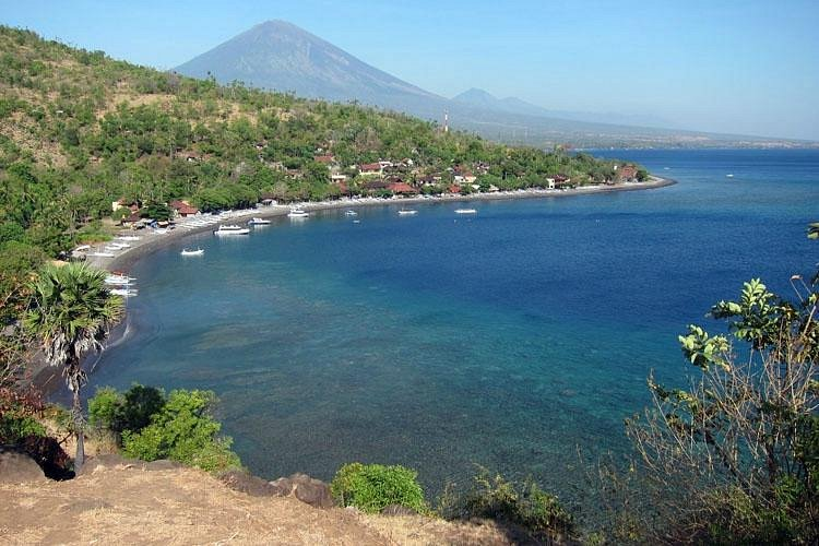 Serene bay, beautiful coral, majestic mountain…life in Amed, Bali