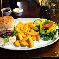 Homemade burger with cheese and bacon, with Chips and Salad
