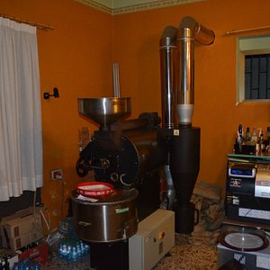 Coffee bean roasting machine tucked in the corner of the shop