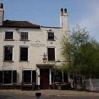 Outside the Spaniards Inn pub in Hampstead, London