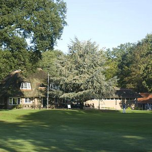 The charming clubhouse of the golfclub Driene in the woodlands