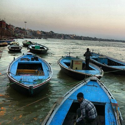 Row boat on Ganges River at dawn