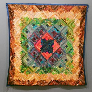 Embroidered Patchwork Quilt by Clementina Manta