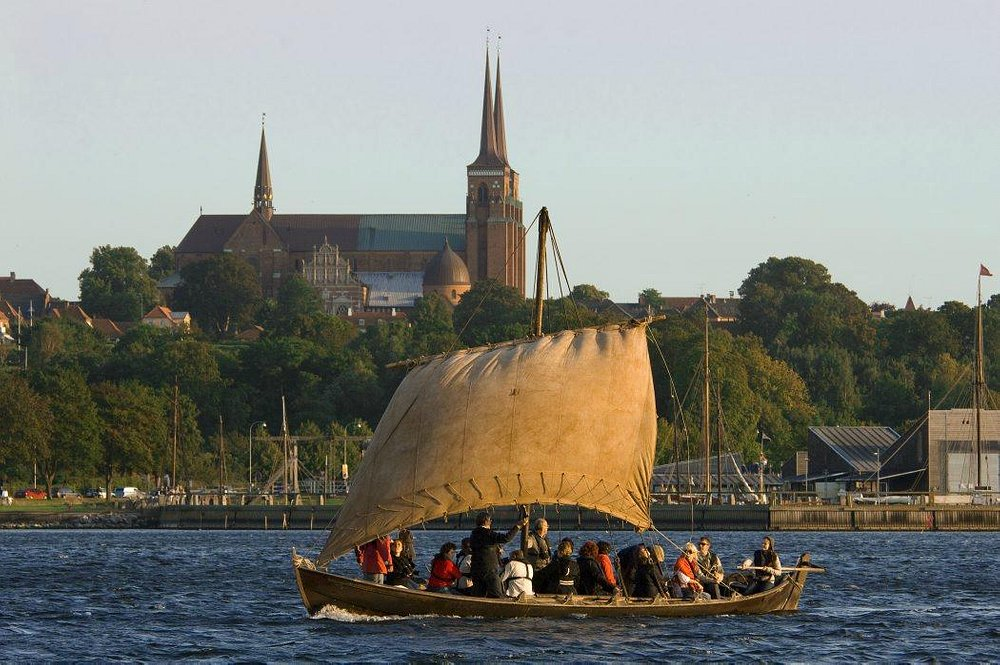 The Viking Ship Museum is located on the shore of the fjord in the old Danish town of Roskilde.