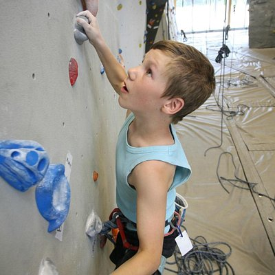The climbing gym is enjoyed by people of all ages