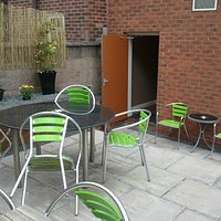 Outdoor seating and smoking area to the rear