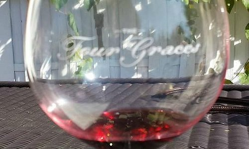 Enjoying a glass of pinot noir at Four Graces