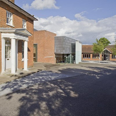 The original Edwardian farm house sits alongside the state of the art  theatre and foyer spaces