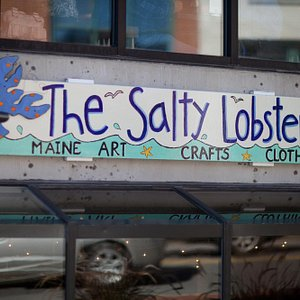 See our sign and come down the stairs fror local Maine art
