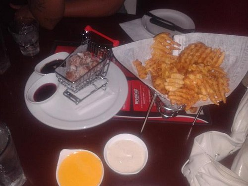 donut holes with chocolate sauce and waffle fries with cheese dip and ranch