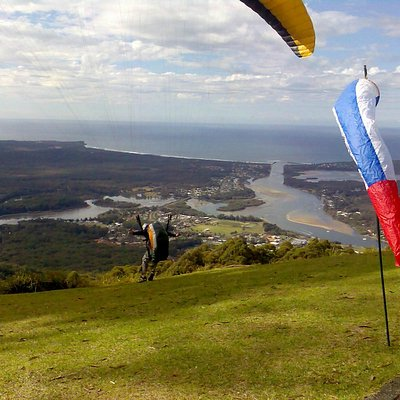 Paragliders take off from the mountain