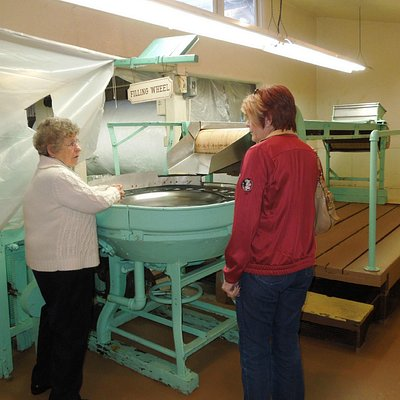 Our guide (left) explains the canning machine