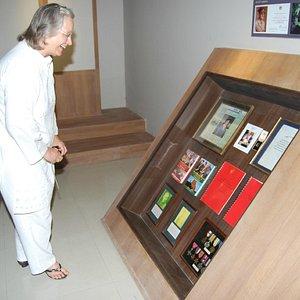 Aline Dobbie looking at her Family memorabilia in Museum