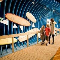 Vintage surfboards on display along the boardwalk