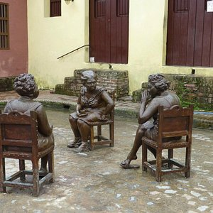 3 gossiping women in the square outside