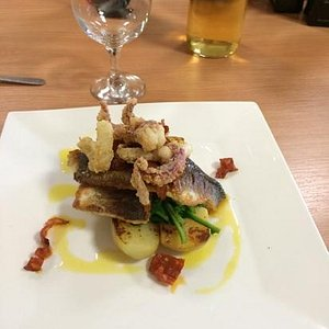 pan fried sea bass on wilted spinach and potatoes with salt and chilli squid- tasted great even