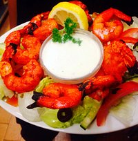 Delicious and well presented tandoori prawn!
