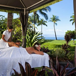 Outdoor, ocean view cabanas allow you to unwind with the tropical breezes