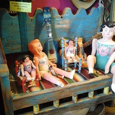 Vintage dolls, bench, small guitar