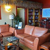 Tropical Room in the back... books, games, TV; nice little family room area!