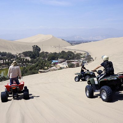 Dune buggying near the oasis (in Huacachina, Ica, Peru)
