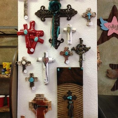 Our cross wall includes work from local and US artists.