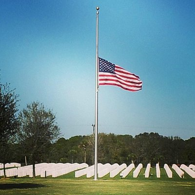 Flag at half-mast over markers