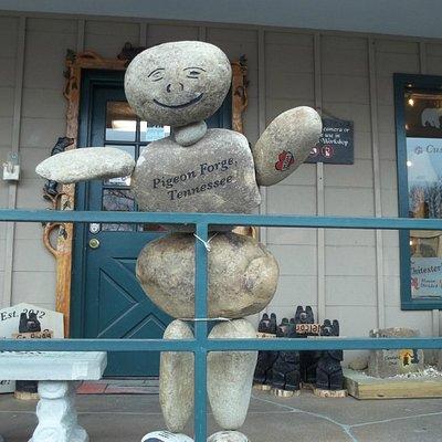 stone man outside shop