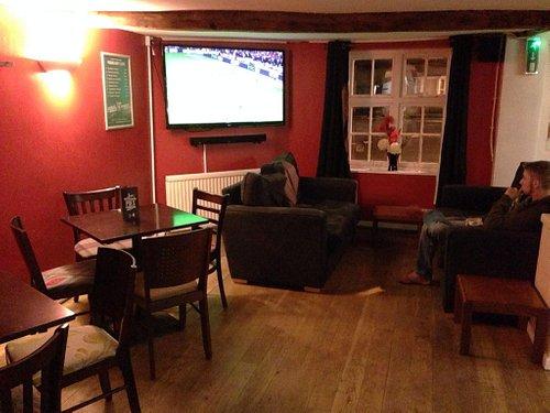 Spacious area with multiple TVs located around the pub