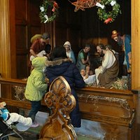 Children admire the crib